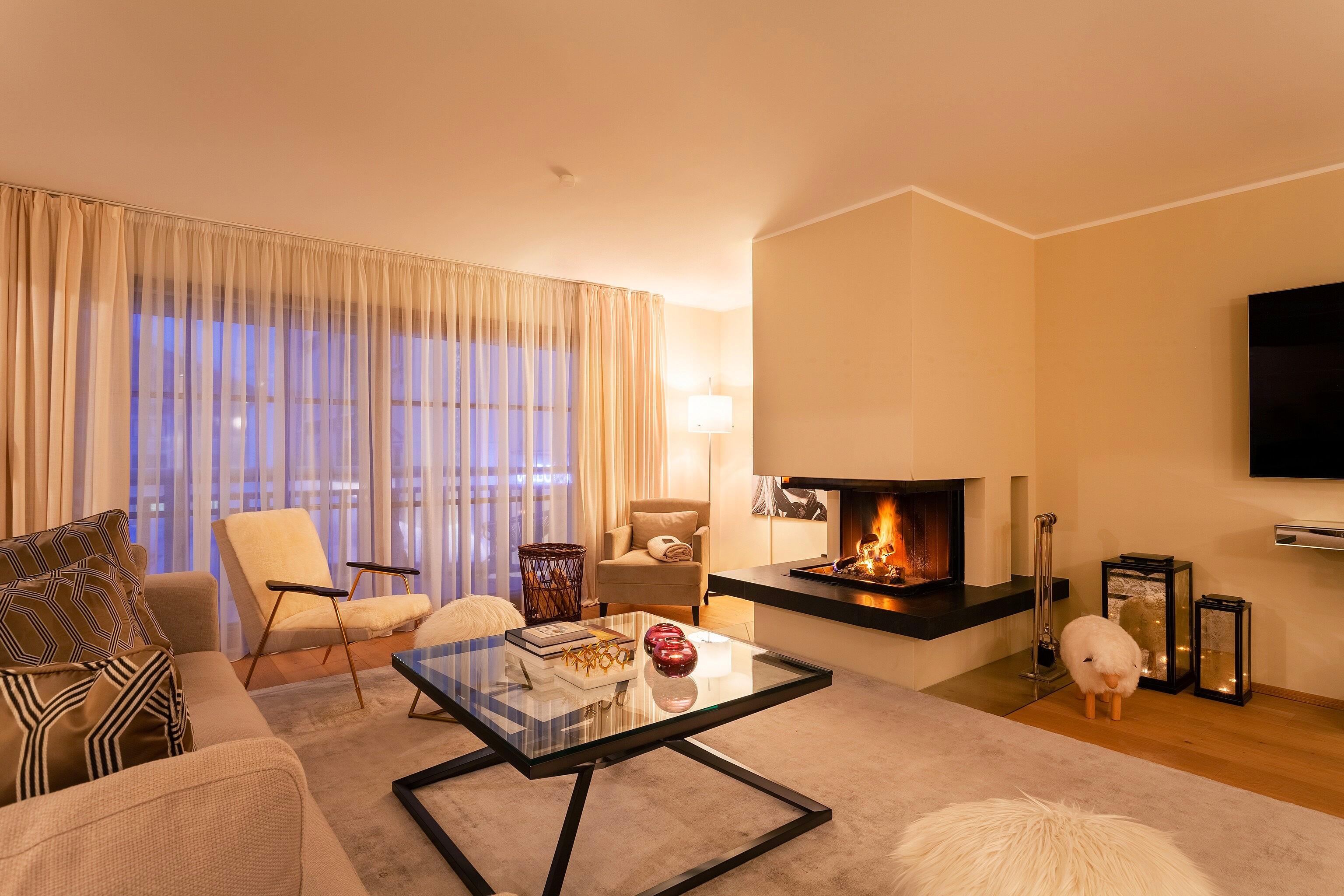 Slider - Apartment 4 - Wohnzimmer mit Kamin