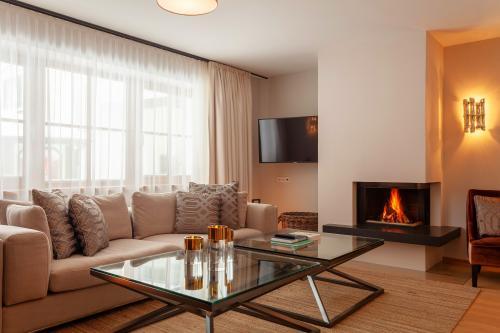 Thurnher's Residences - Apartment 1 - Wohnzimmer mit Kamin